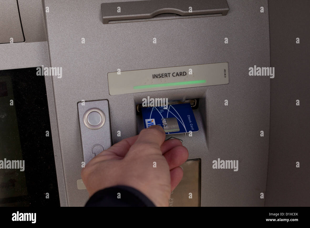 Man inserting bankcard into ATM - Stock Image