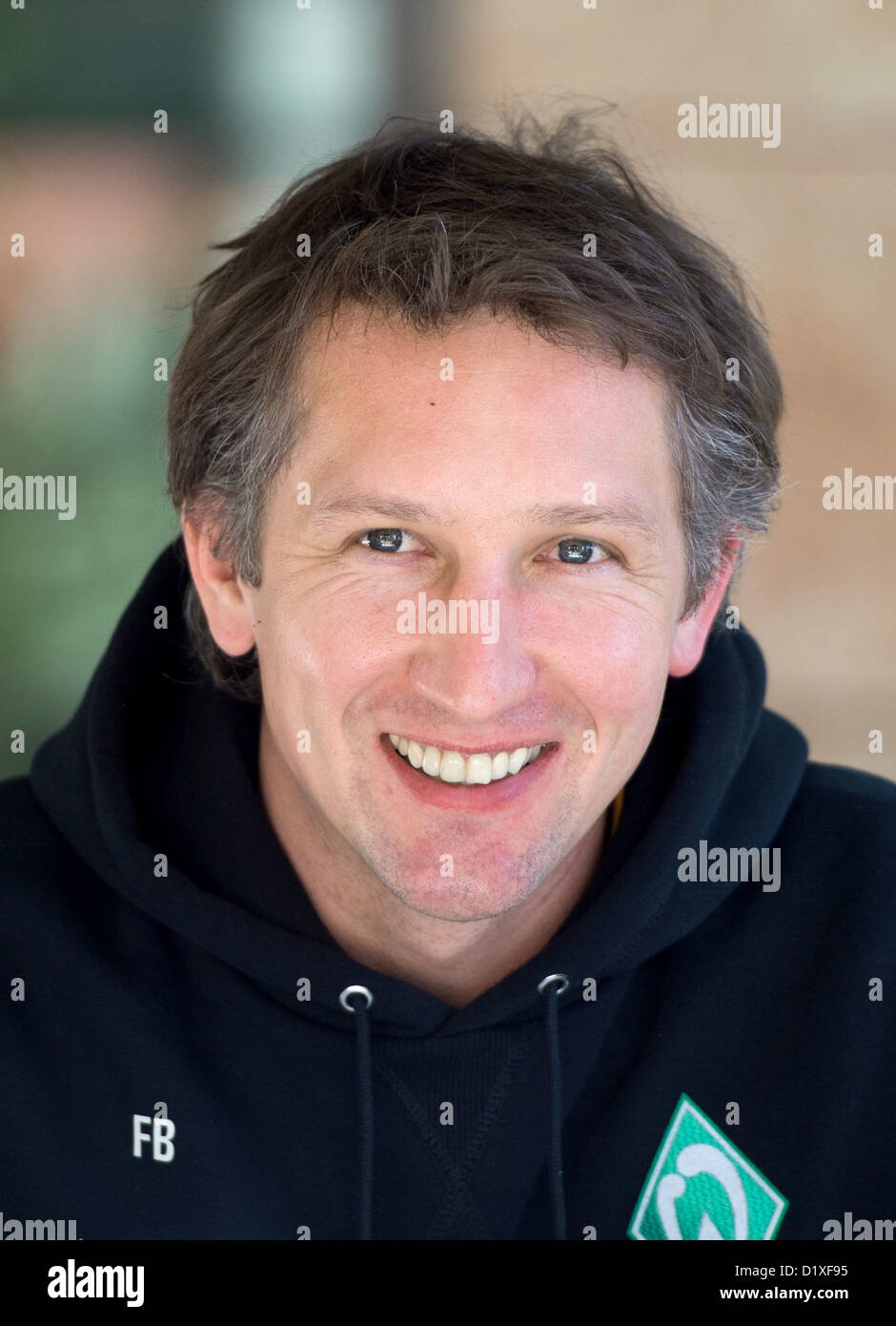 Werder Bremen's Scouting and Professional Soccer Director Frank Baumann smiles at a press conference during - Stock Image