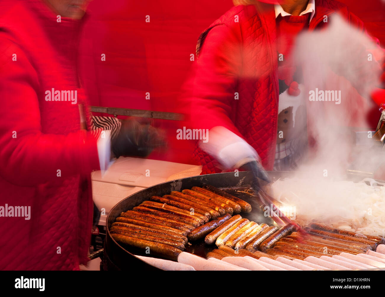 Selling Food and Frying Sausages at the Christmas Fayre and Festive Dickensian festival in Skipton High Street, Stock Photo