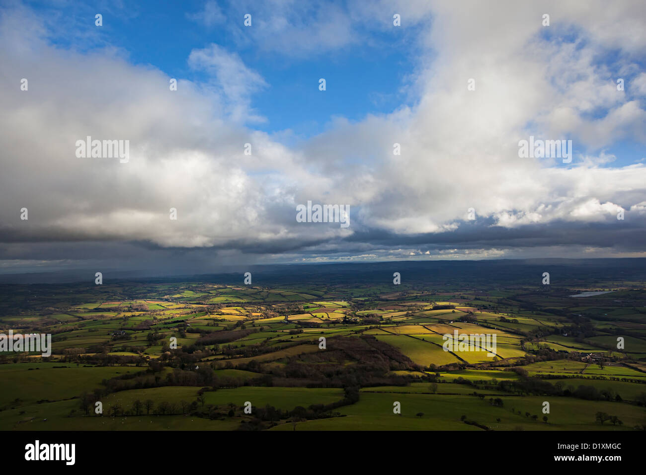 Fields partially lit by gaps in the clouds, seen from the Skirrid mountain, Wales, UK - Stock Image