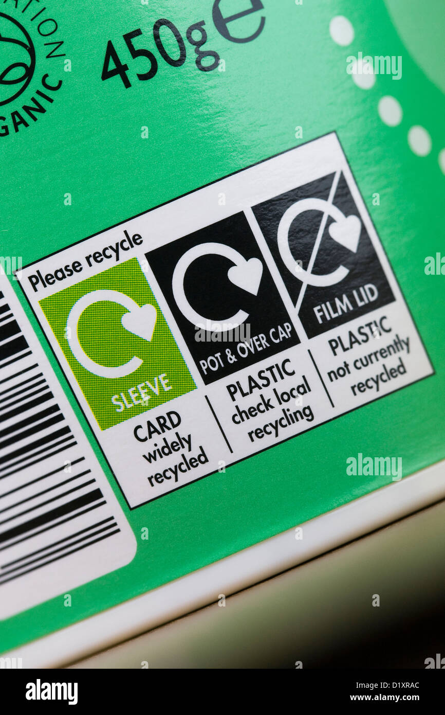 Recycling symbol on the label of a yogurt carton. - Stock Image