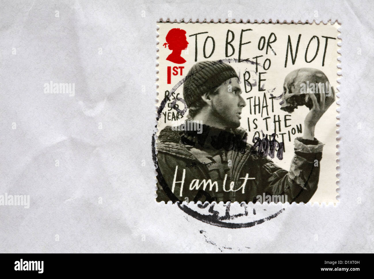 1st class stamp commemorating RSC 50 years - to be or not to be that is the question Hamlet stuck on white envelope - Stock Image