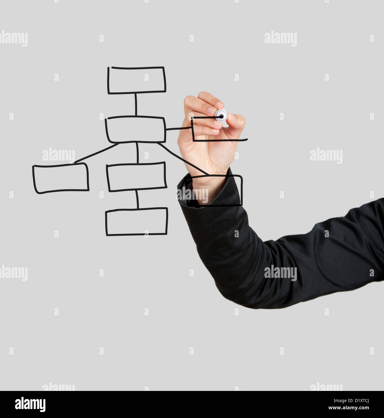 Beautiful woman drawing a diagram on glass board with a marker - Stock Image