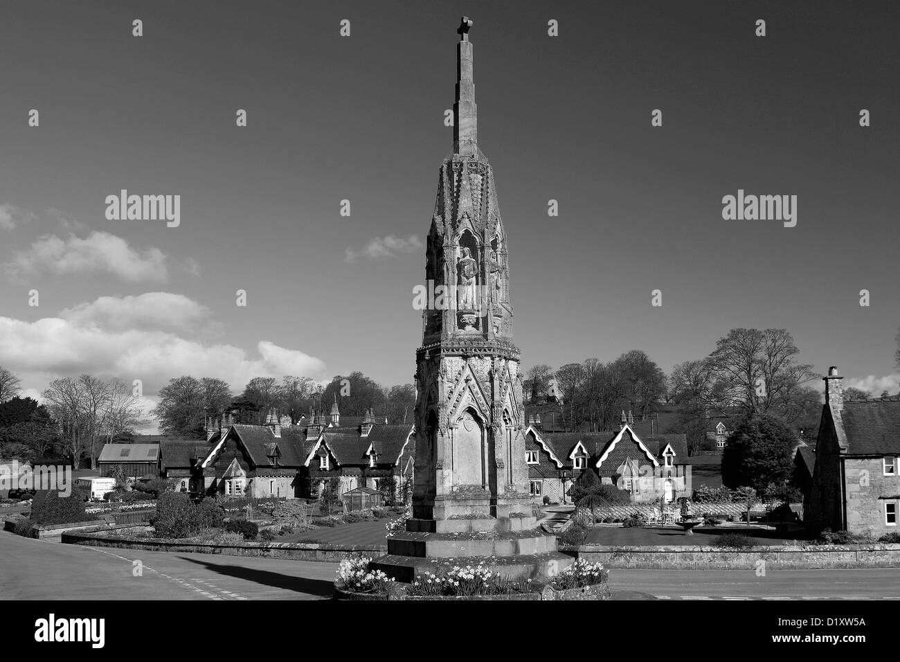 Stone memorial cross, village of Ilam, Staffordshire, Peak, District, National, Park, England, UK - Stock Image