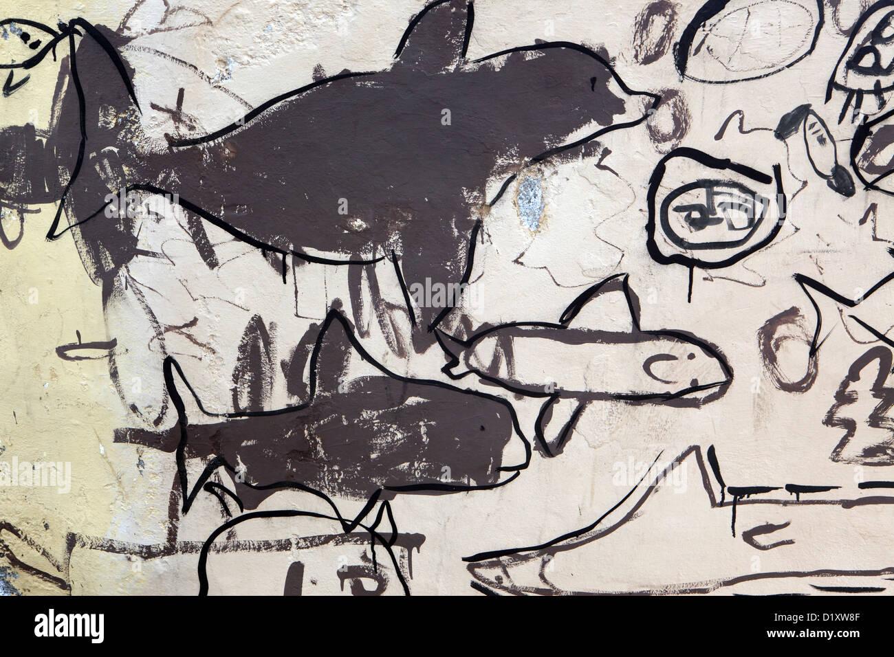 Naive childlike scrawling drawing graffiti art artwork, nautical themes on wall, Puerto de la Cruz, Tenerife, Canary - Stock Image