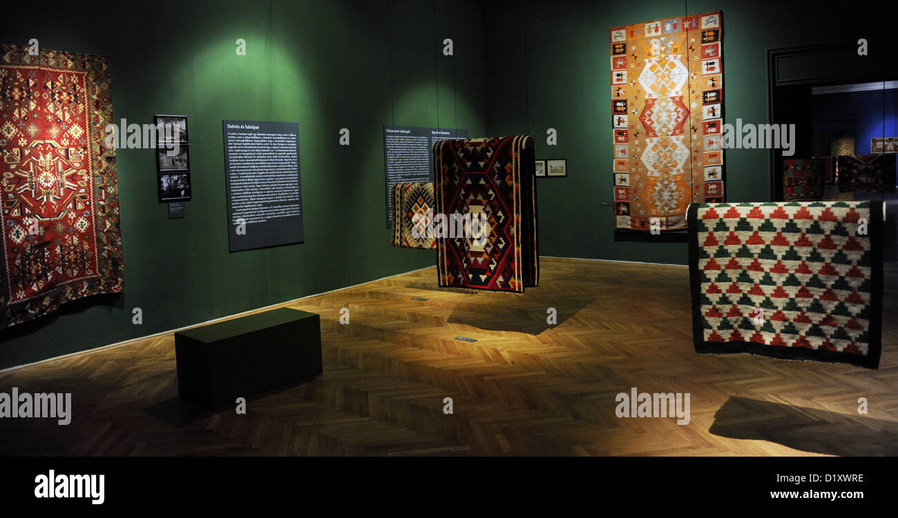 Rugs in a room dedicated to working women and the beginning of the industry. Interior. Ethnographic Museum. Budapest. - Stock Image