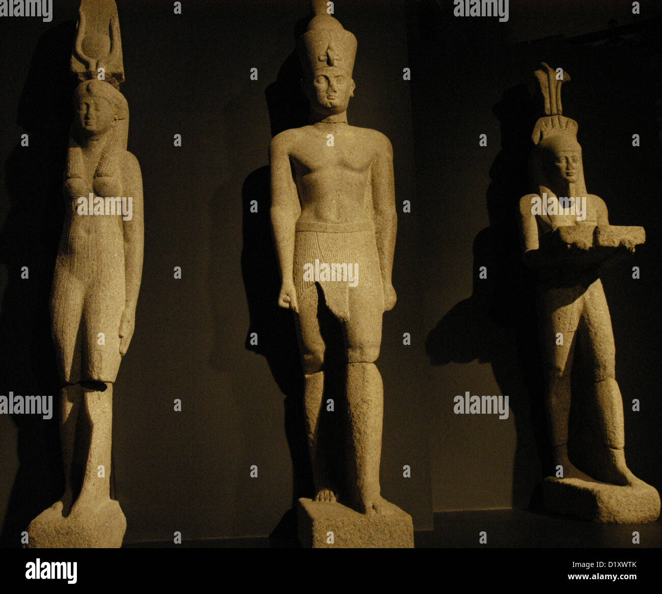 Egyptian art. Colossal statues of a pharaoh, his wife and the god Hapi (God of fertility). - Stock Image