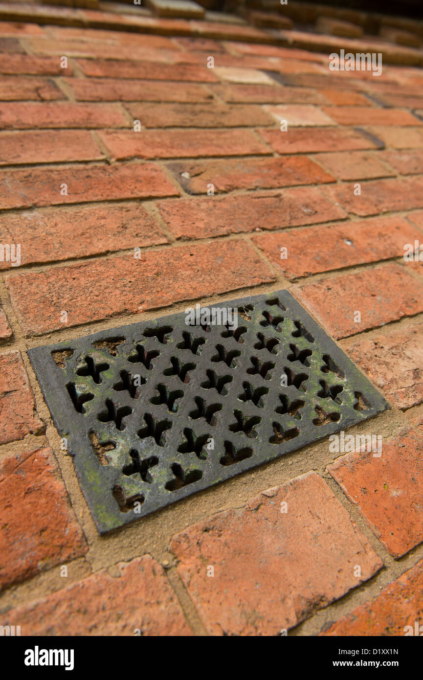 Close up view of a cast iron vent in the exterior wall of a newly ...