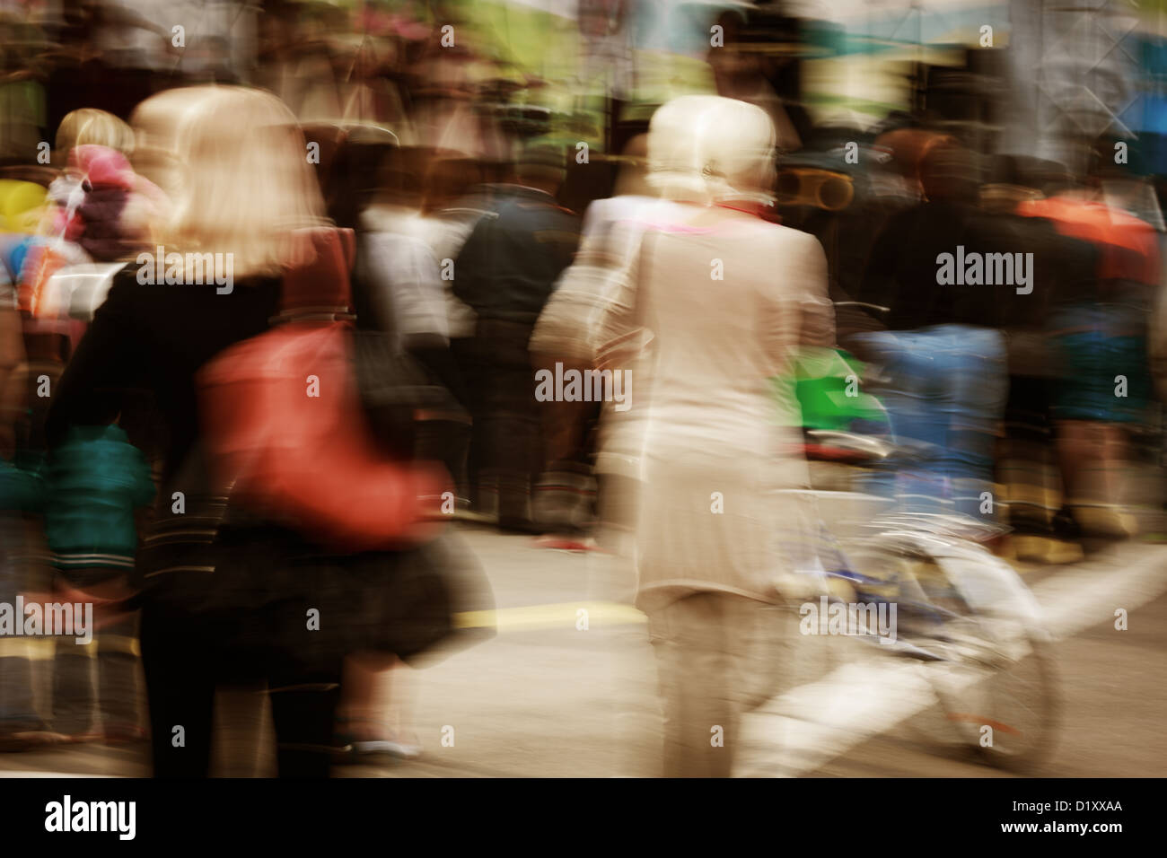 walking people in motion blur - Stock Image