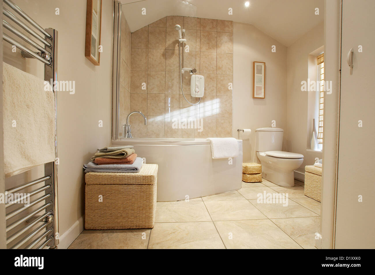 A modern contemporary bathroom with a jacuzzi corner bath Stock ...