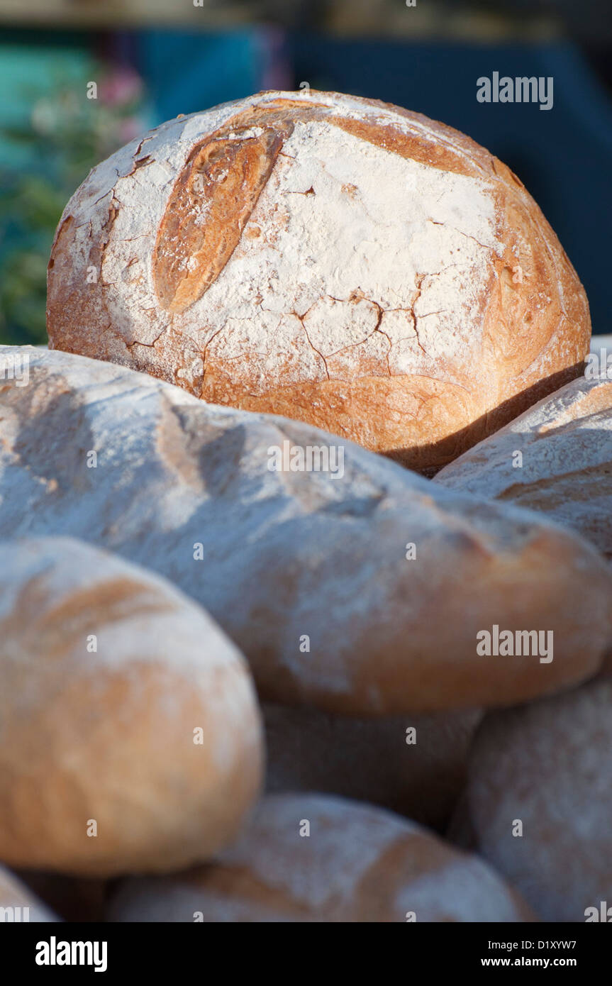bread, loaves, locally produced, artisan, baking, bakery, sunlit, selective focus, country fair - Stock Image