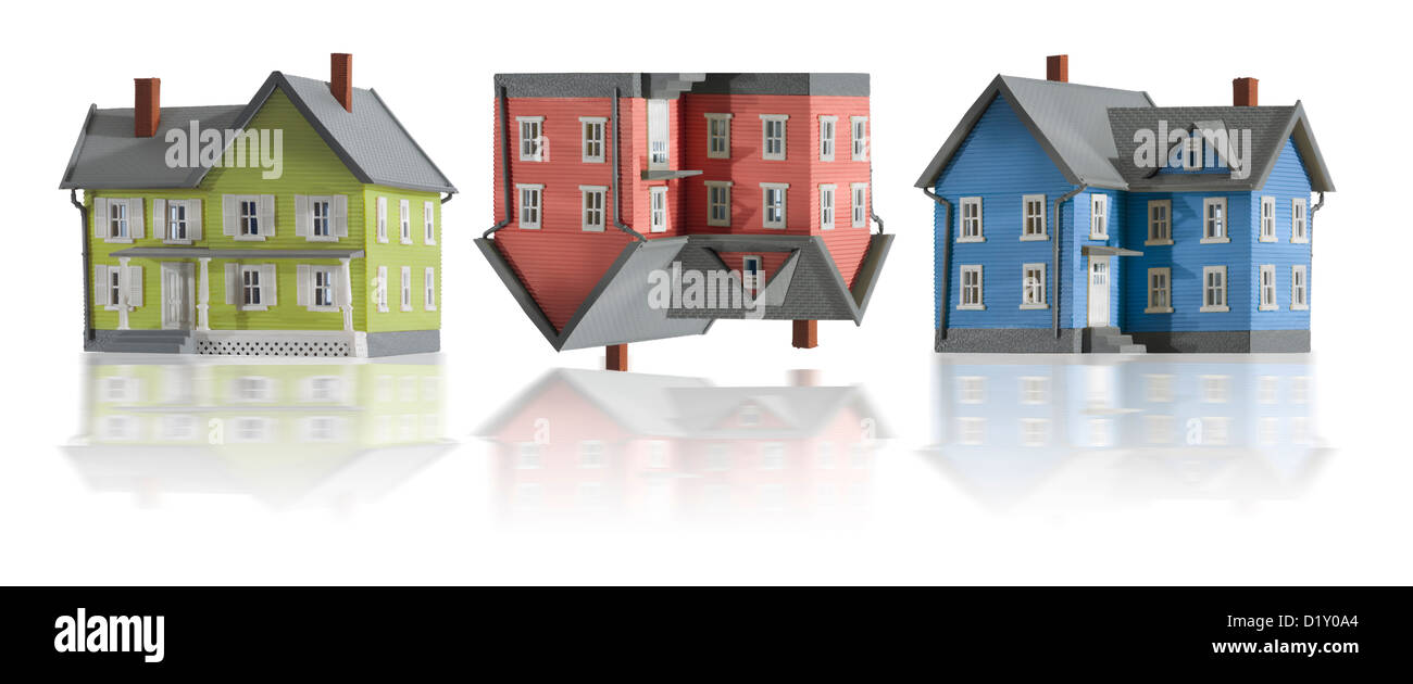 Three houses in a row.  Houses denotes creative concept of the declining real estate market. - Stock Image