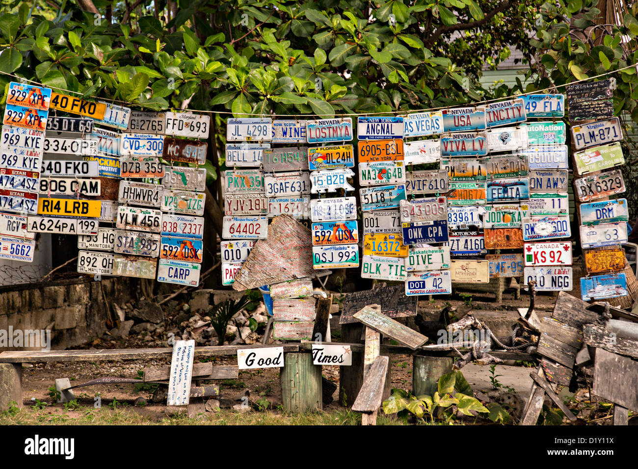 Quirky signs and old license plates at Uncle Ralph's Aura Corner, Dunmore Town, Harbour Island, The Bahamas. - Stock Image