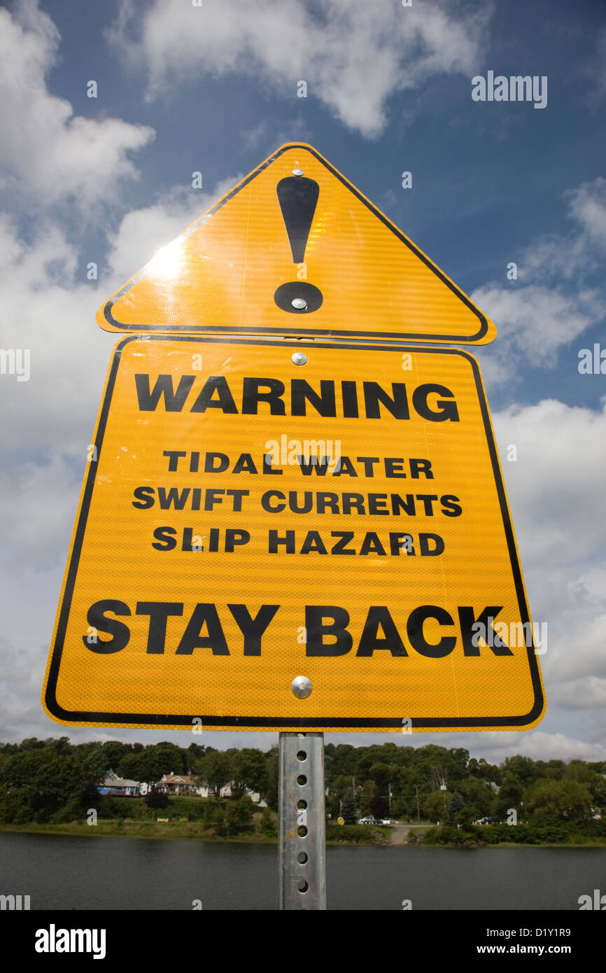 Warning sign of tidal waters and swift currents of the East River in New Glasgow, Nova Scotia - Stock Image