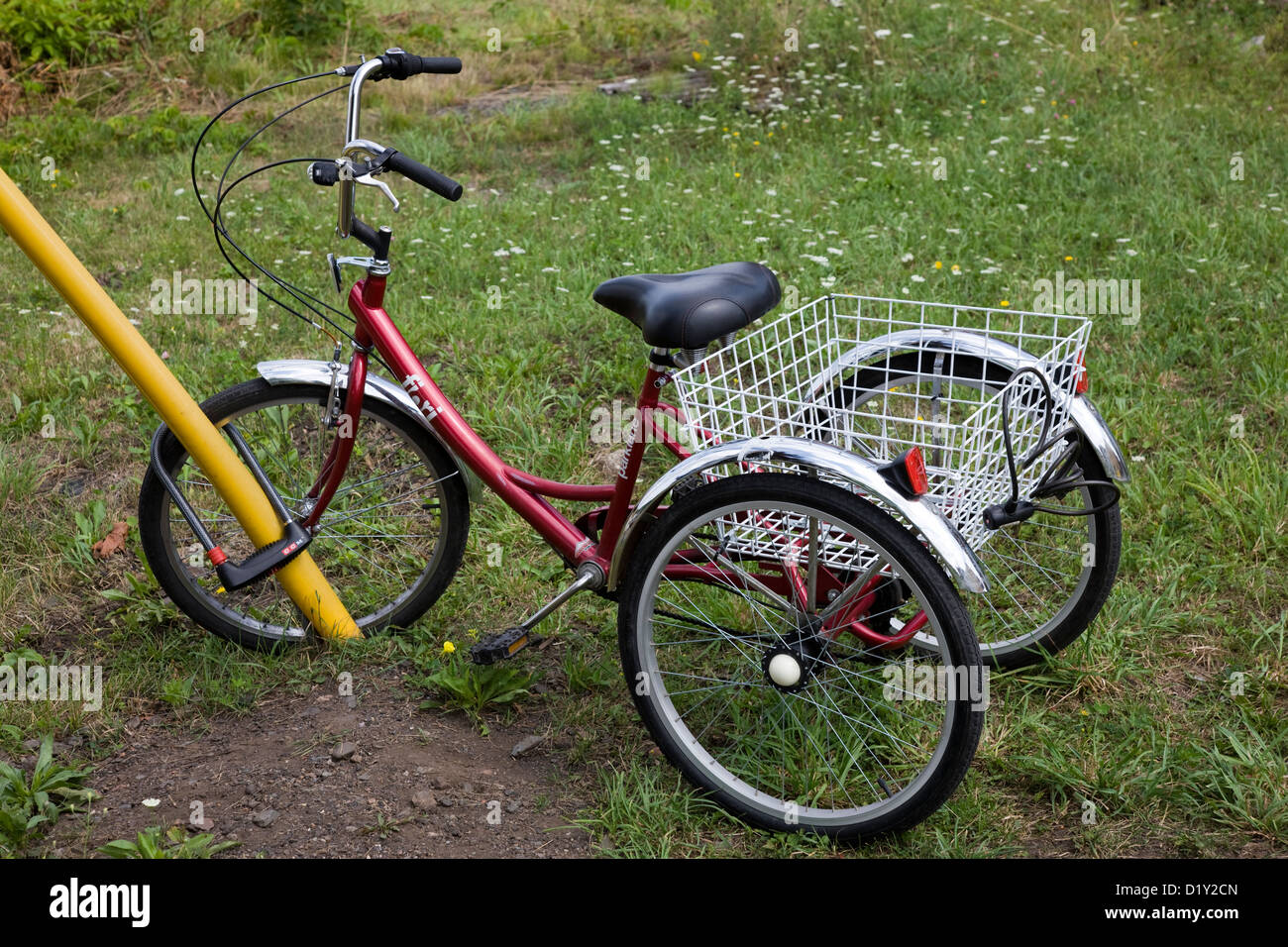 A tricycle parked behind offices in New Glasgow, Nova Scotia - Stock Image