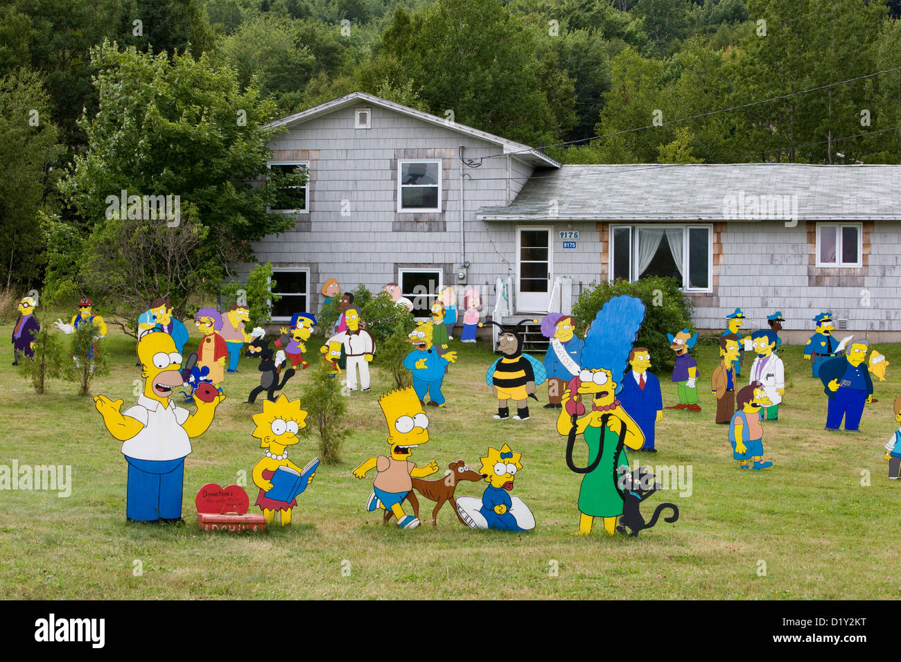 The Simpsons family cartoon characters cardboard cutouts in a garden in Nova Scotia - Stock Image
