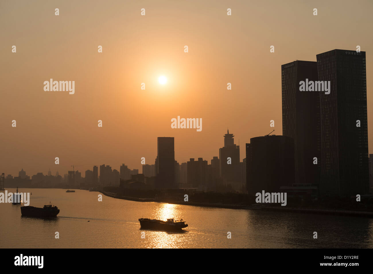 Dramatic View of the Huangpu River and Pudong Skyline at Sunrise, Shanghai, China - Stock Image