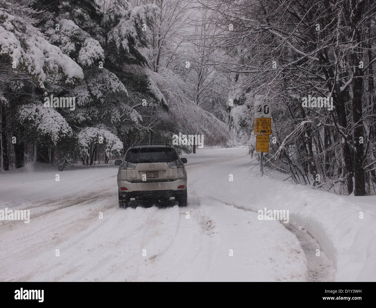 Car driving on winter snowy roads - Stock Image