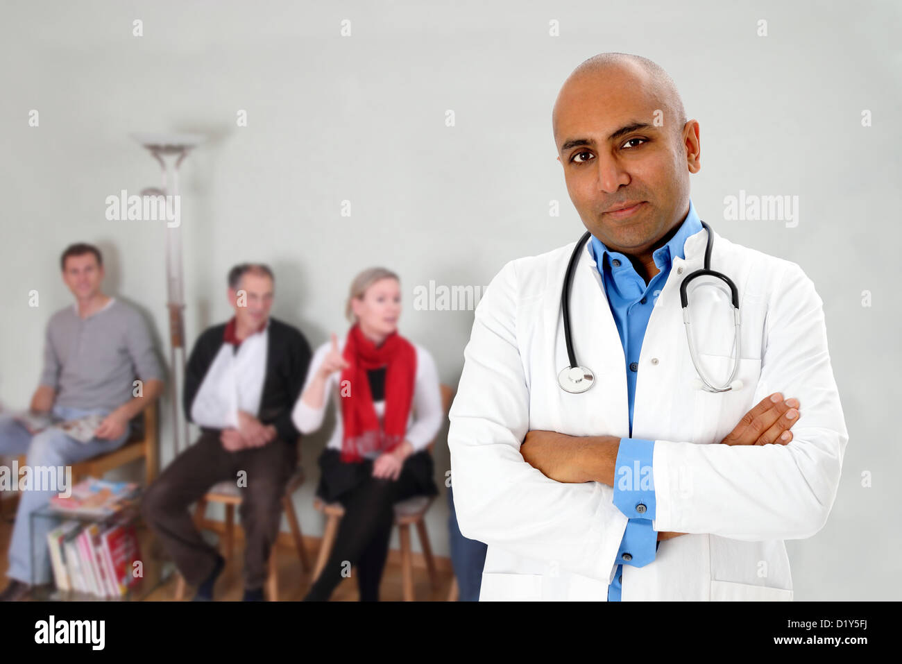 A dark skinned doctor an people waiting in a waiting room - Stock Image
