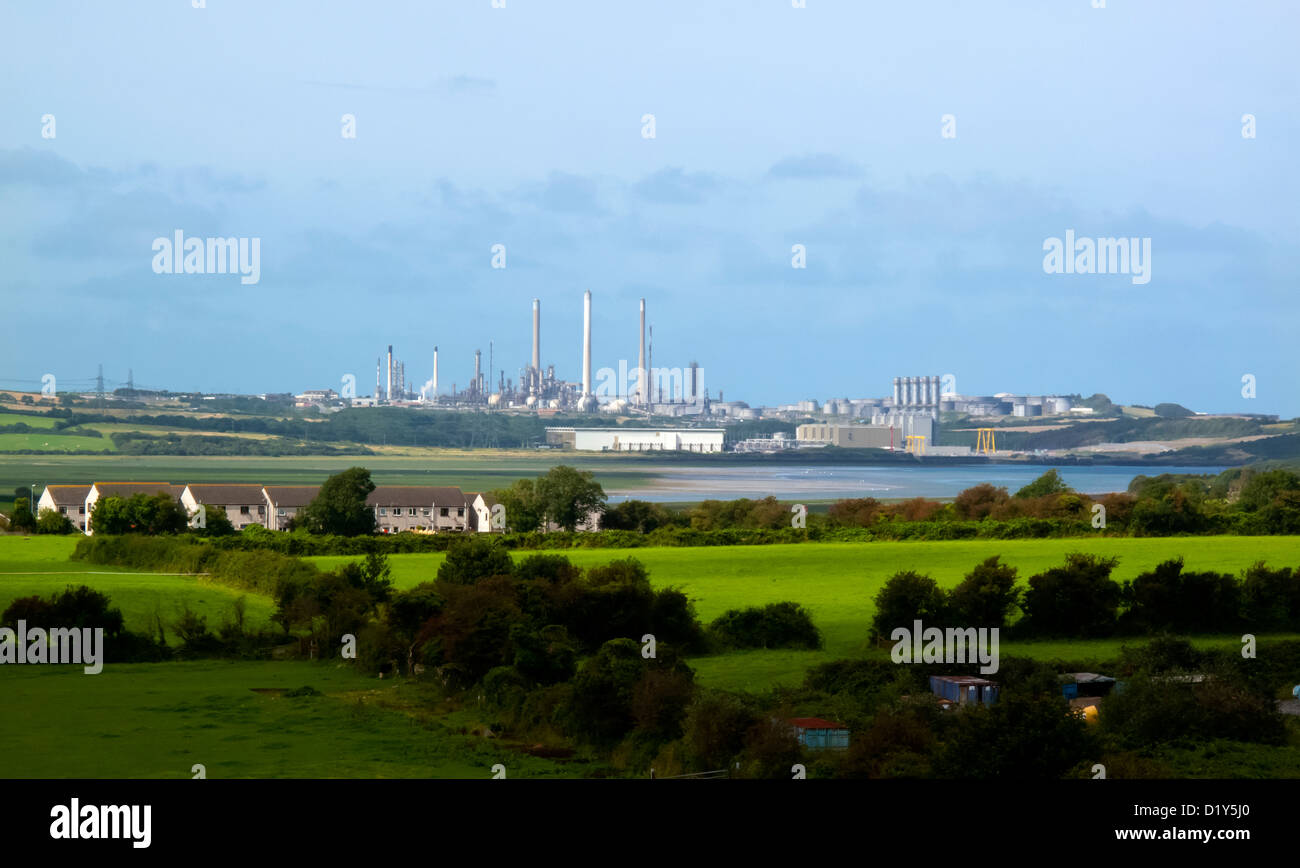 Distant view across fields from Pembroke of Milford Haven oil refinery and LNG gas terminal Pembrokeshire South Wales UK Stock Photo