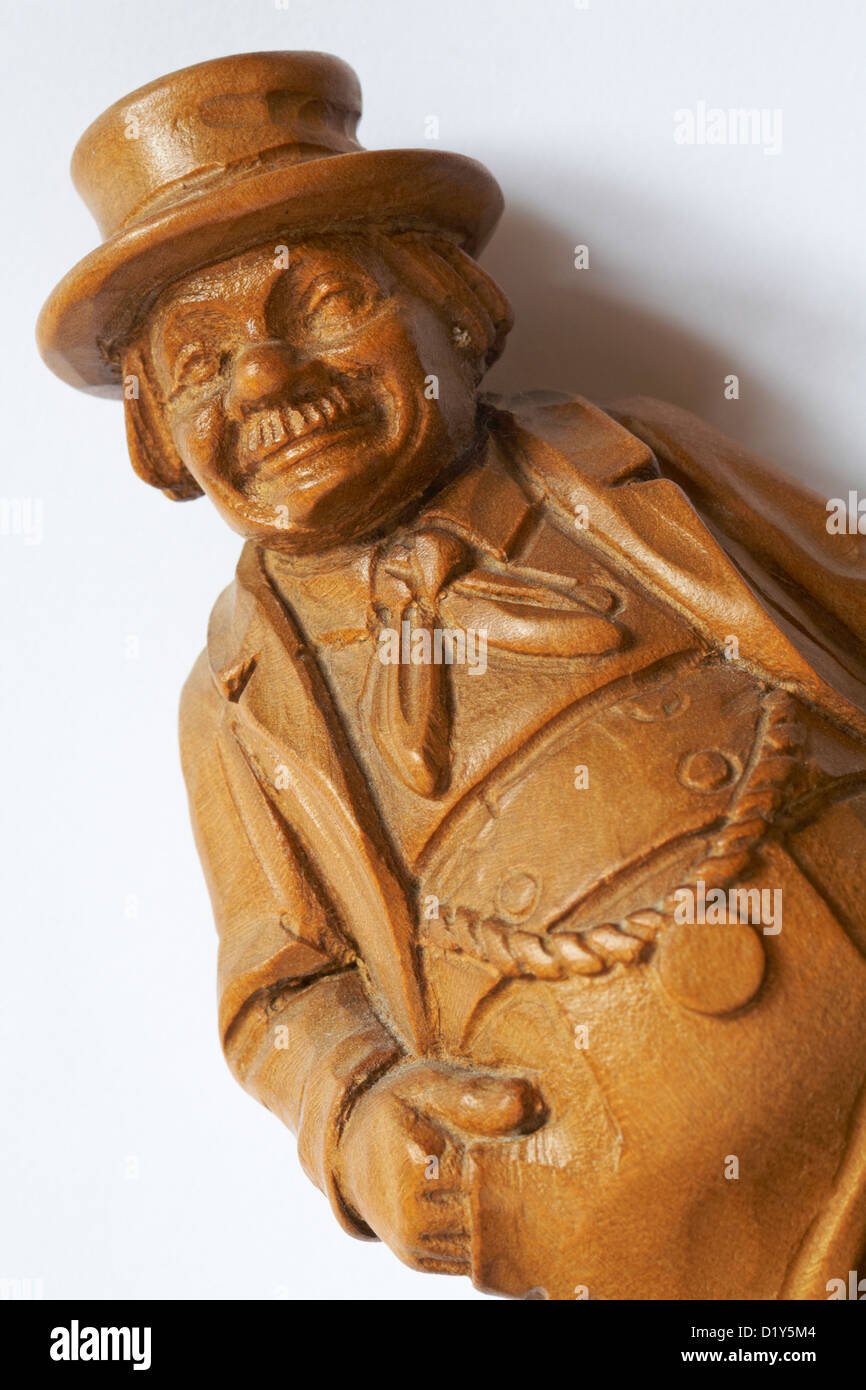 Wood carving of a jolly old fellow set on white background Stock Photo