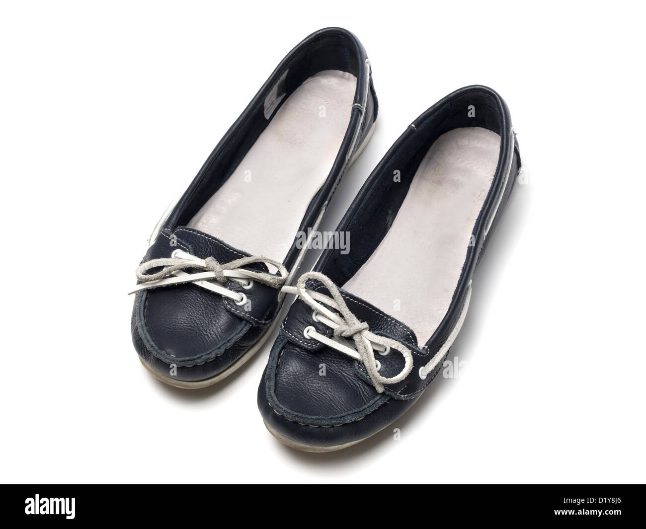 Pair of female blue flat shoes isolated on white background - Stock Image