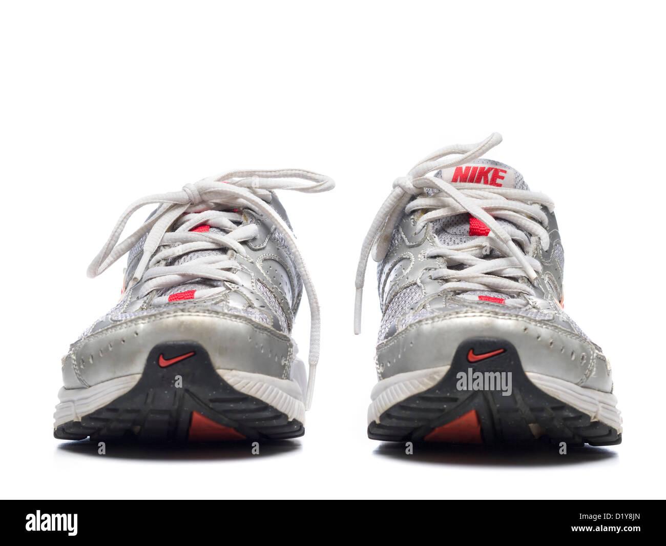 Grey Nike running shoes isolated on white background Stock Photo