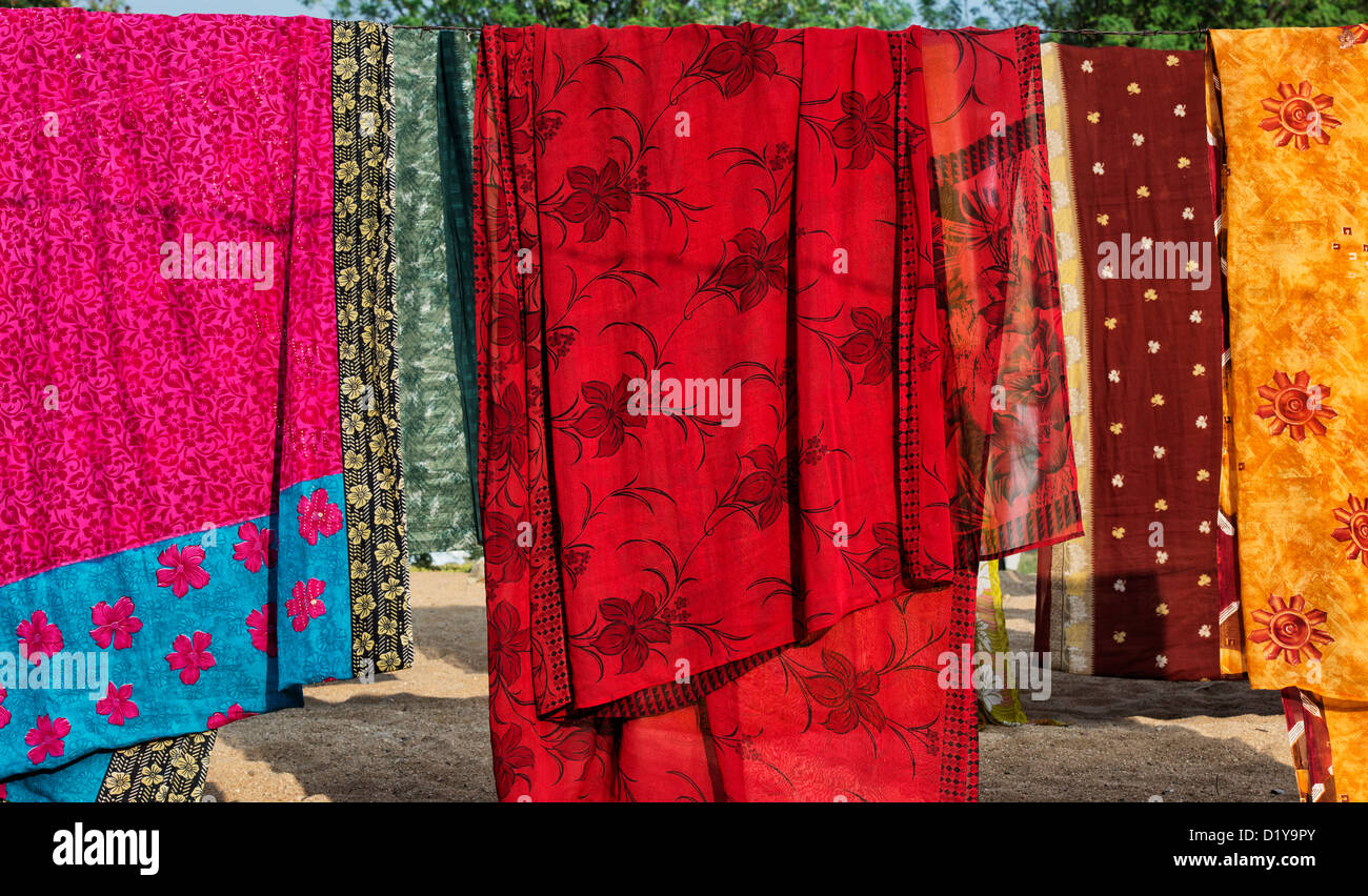 Colourful Indian saris hanging out to dry on a washing line. Andhra Pradesh, India - Stock Image