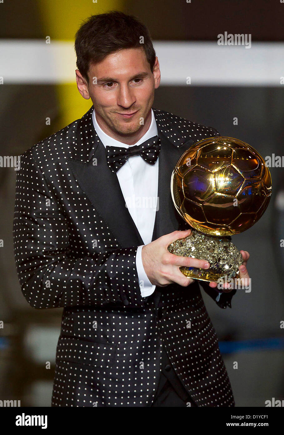 Lionel Messi Of Argentina Holds The Trophy Alloft After Winning FIFA Ballon DOr For A Fourth Consecutive Time During Gala 2012 At