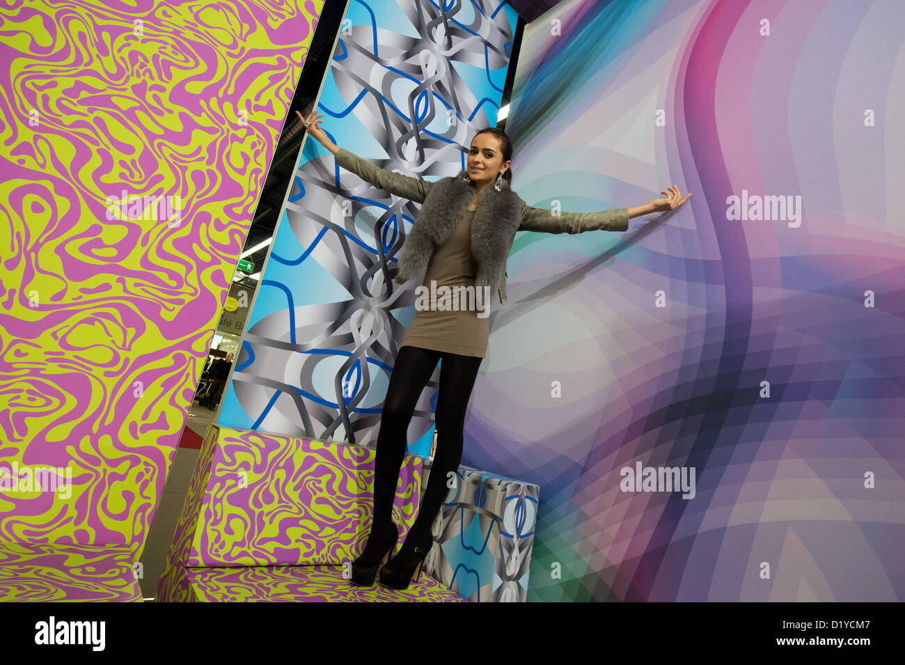 Model Beba presents specially printed colorful wall hangings at the Heimtextil trade fair in Frankfurt Main,Germany, Stock Photo