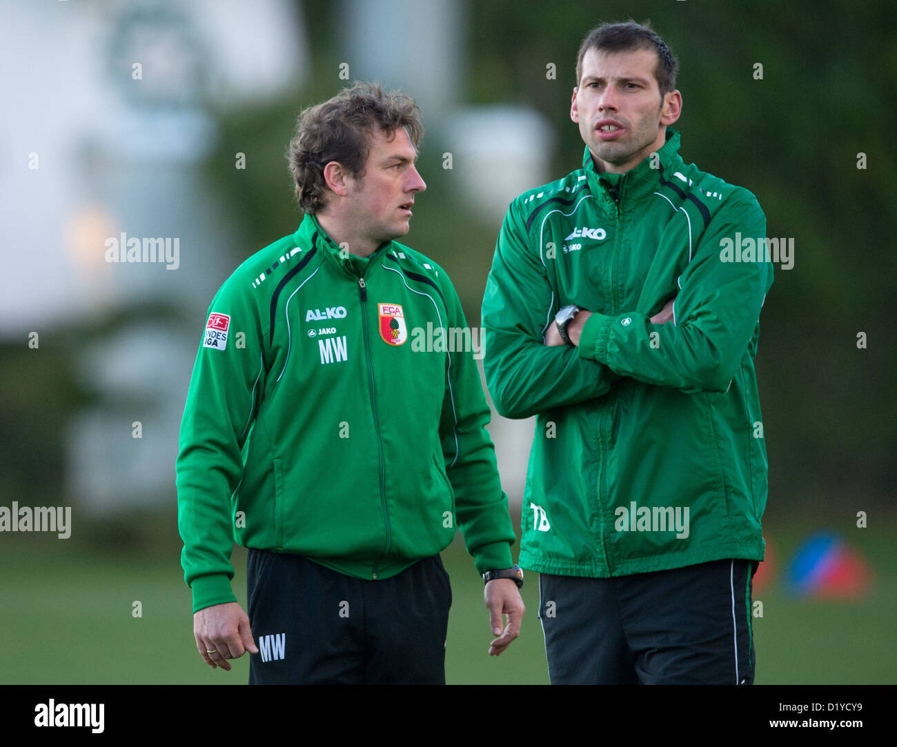 Augsburg's trainer Markus Weinzierl (l) talks to the athletic and rehab trainer Thomas Barth during practice - Stock Image