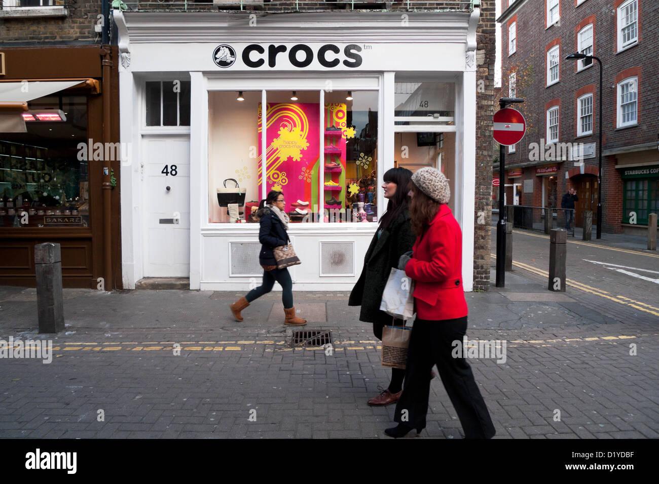 1e036d350 Women walking past the Crocs shoe shop in Neal Street