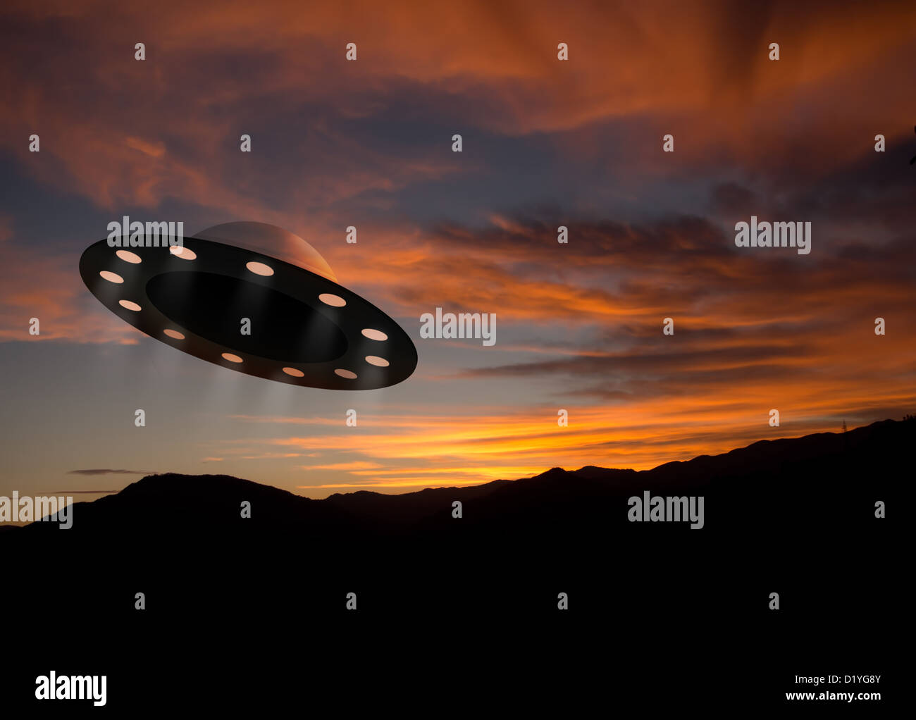 UFO at sunset - Stock Image