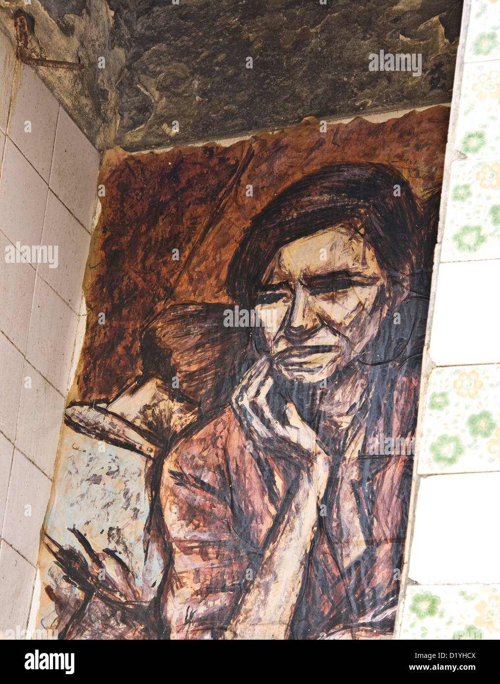Mural of sad woman with child on wall of deserted abandoned house Lisbon Portugal western Europe Stock Photo