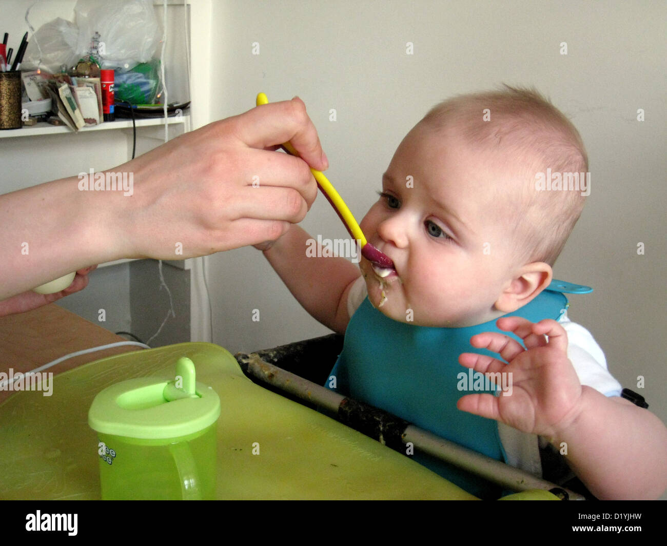 six month old baby being spoon fed - Stock Image