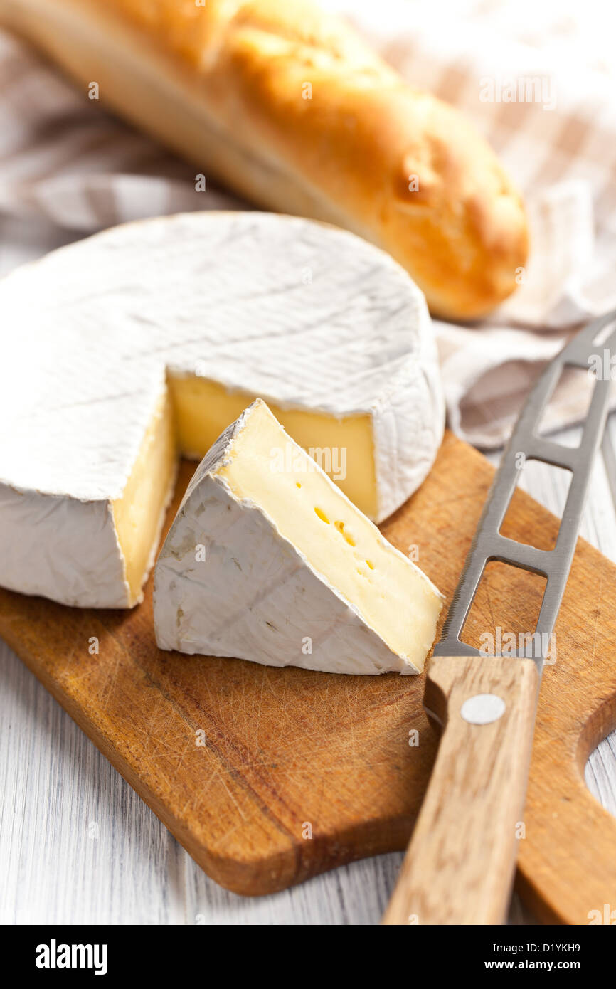 the camembert cheese on kitchen table - Stock Image