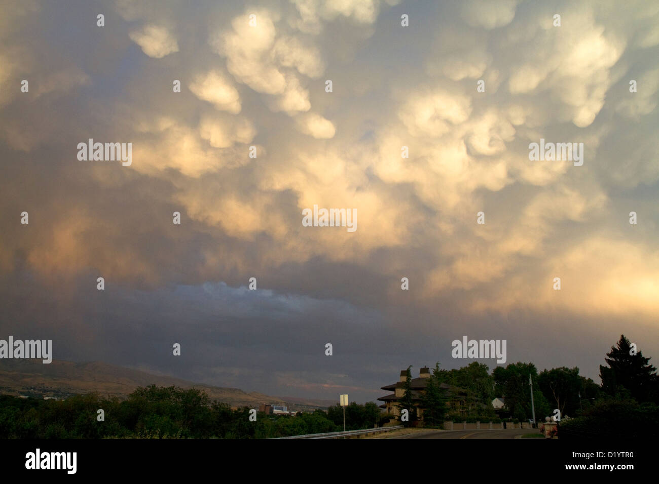 Mammatus clouds drooping with moisture over Boise, Idaho, USA. - Stock Image