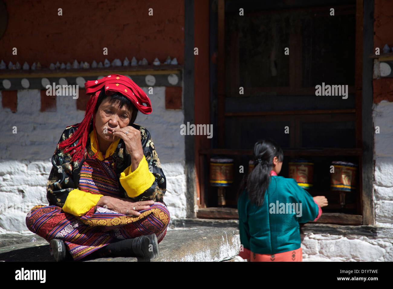 prayer,buddism,ladies dressed in national dresses - Stock Image