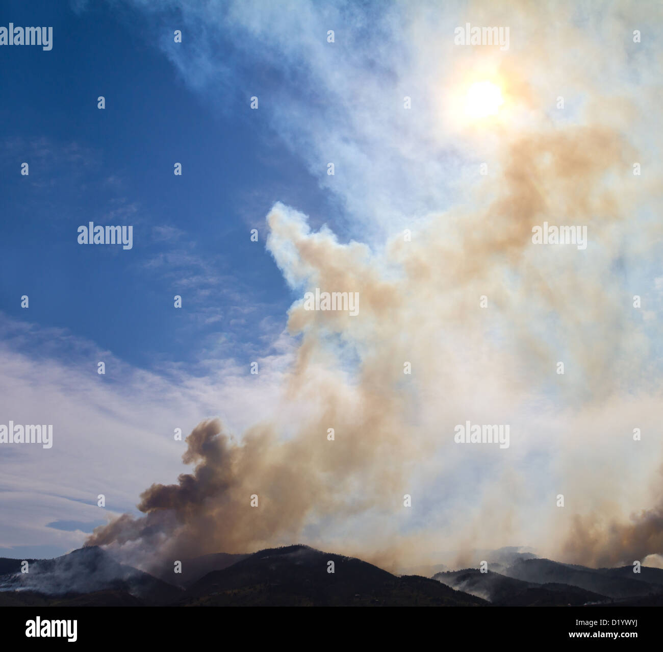 Wildfire smoke rises from burning mountains in Colorado - Stock Image