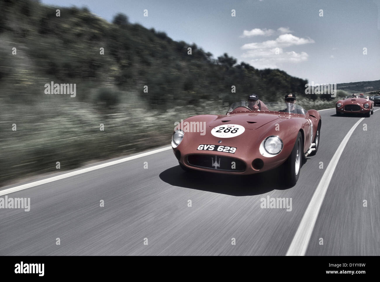 Maserati 300S Sports racing car from the 1950's driving in the 2001 Mille Miglia. - Stock Image