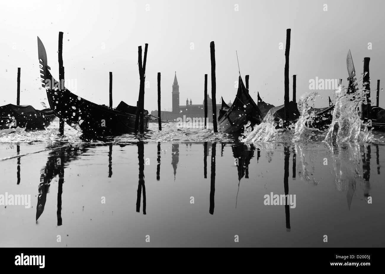 Gondolas, water spray, San Giorgio Maggiore, Venice, Italy - Stock Image