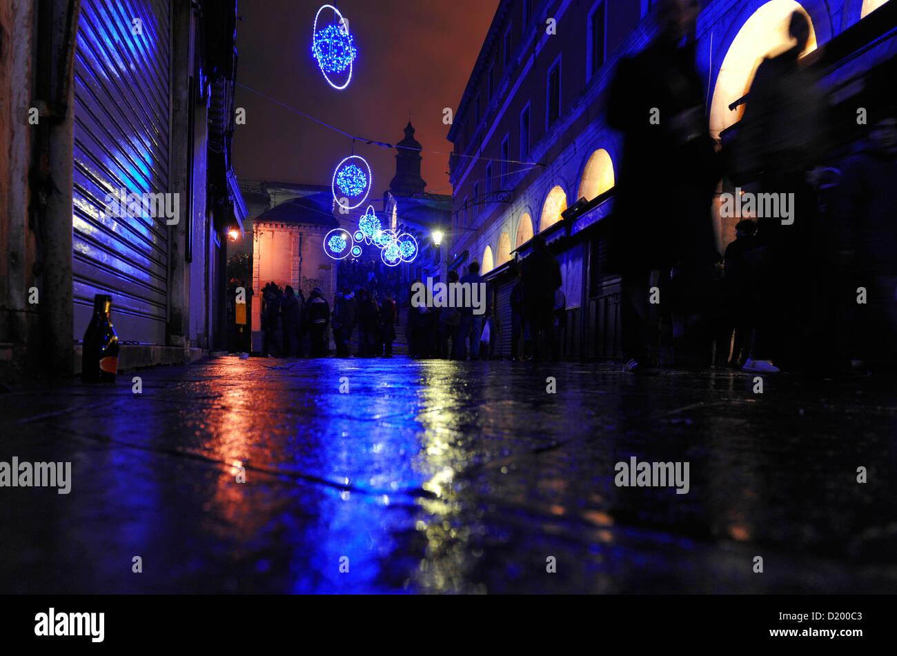 Neon lights in the street at night, New Year's Eve, near the Rialto Bridge, Venice, Italy - Stock Image