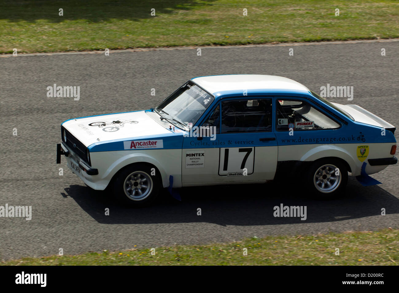 Christopher Penfold driving a 1976 Ford Escort MkII, in the sprint race at  the 'motorsport at the palace' - Stock Image