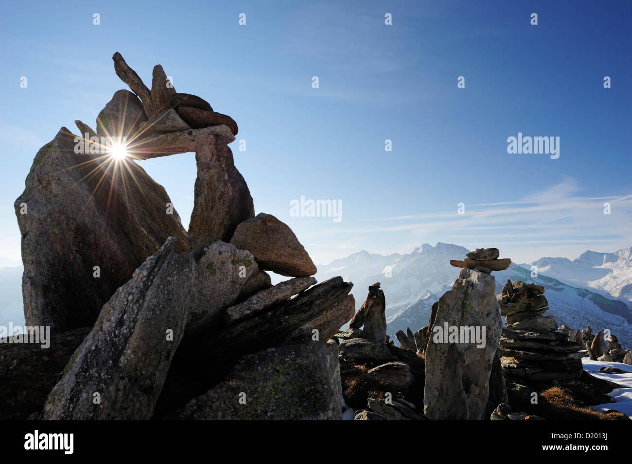 Cairn with sunstar, Zillertal mountain range, Zillertal, Tyrol, Austria - Stock Image