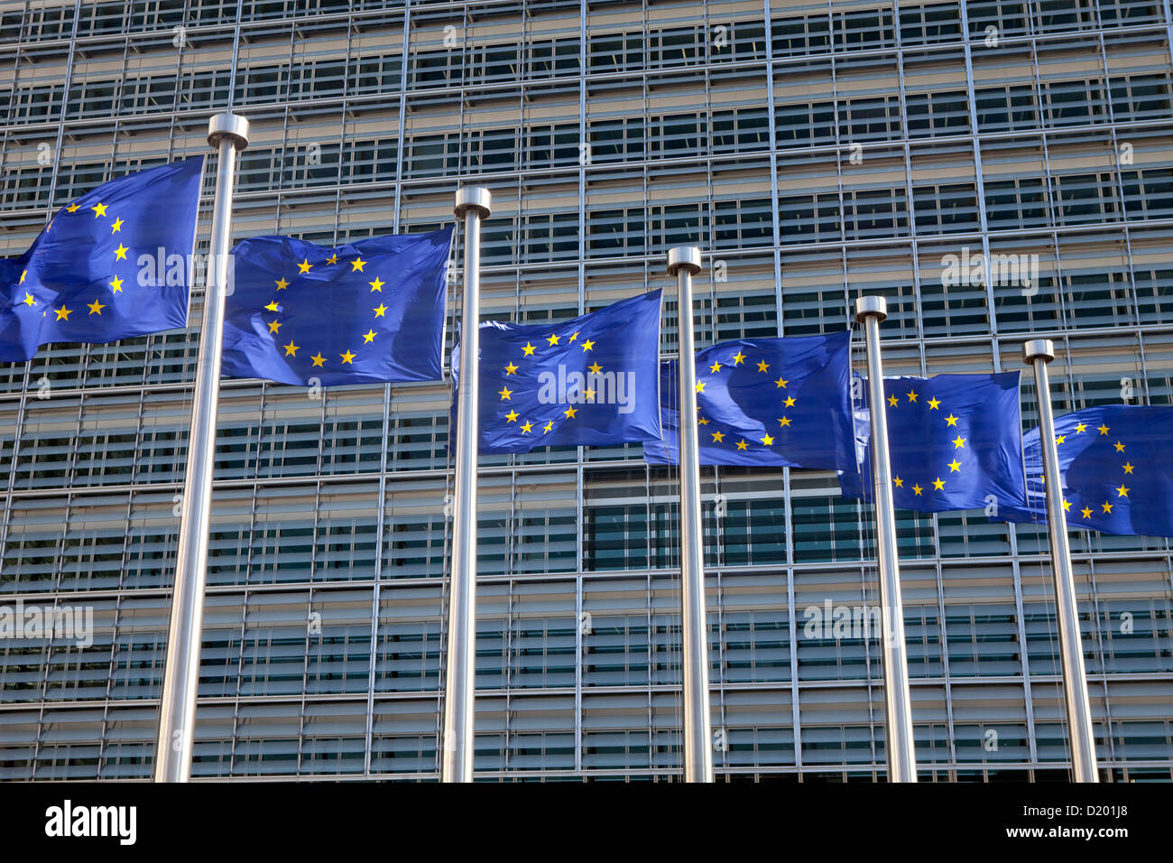 Brussels, Belgium European flags in front of the Berlaymont building - Stock Image