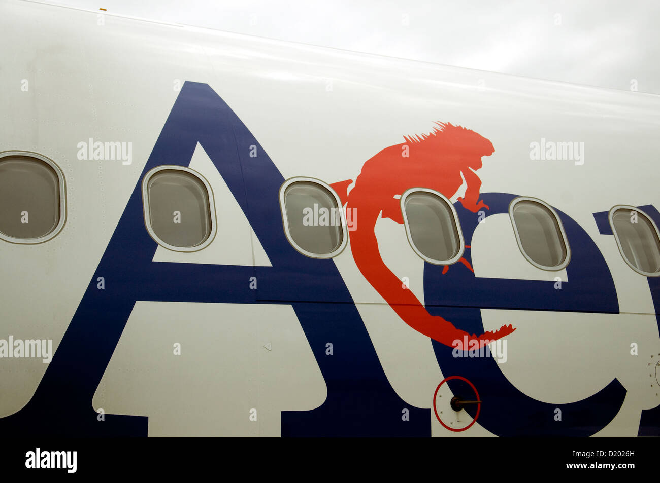 Iguanas, dominant image of Ecuador's Galapagos islands, adorn the paintwork of the local domestic airline Aerogal - Stock Image
