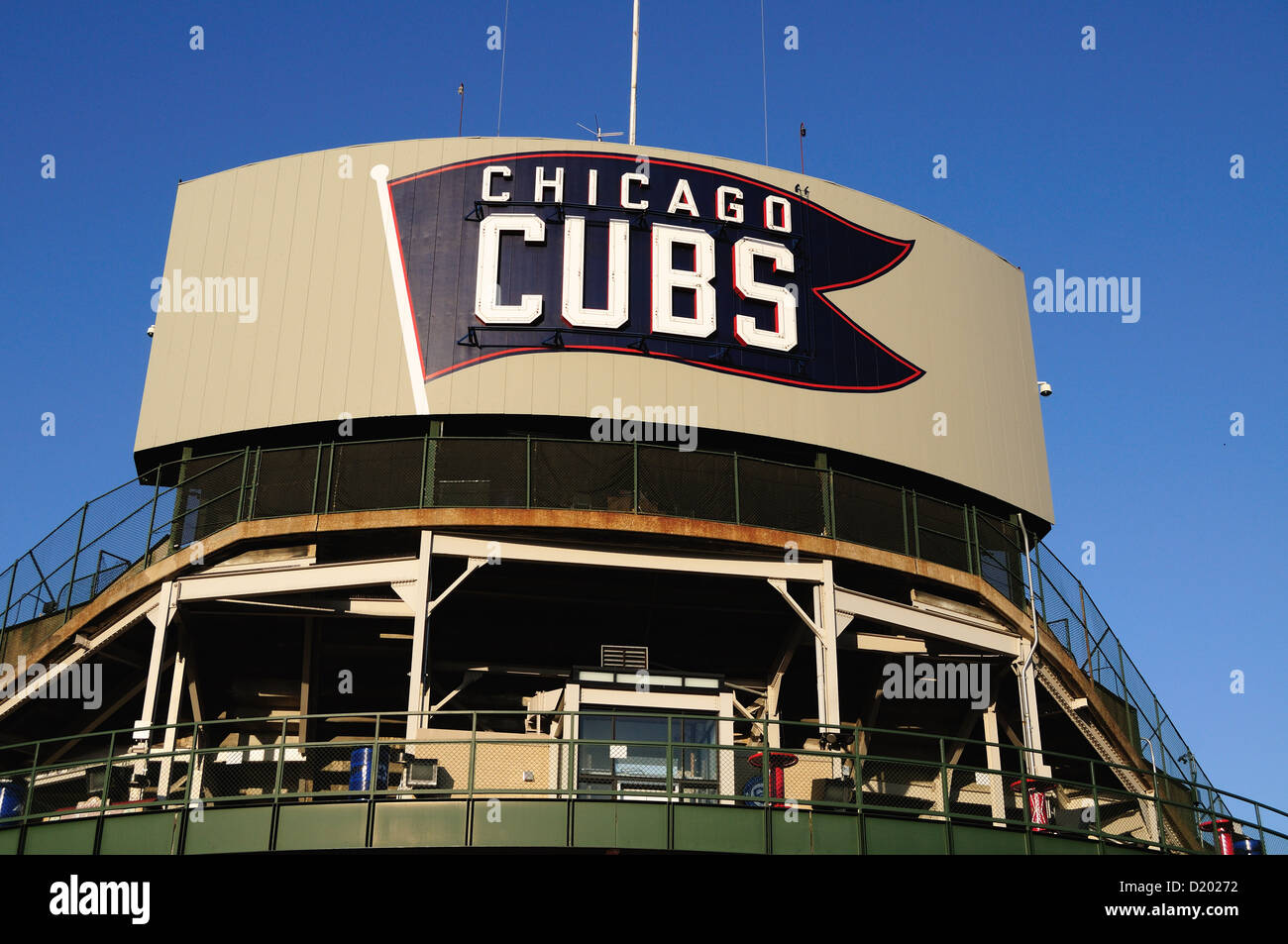 USA Illinois Chicago Wrigley Field marquee on the back side of the ballpark's scoreboard rests above the bleacher - Stock Image