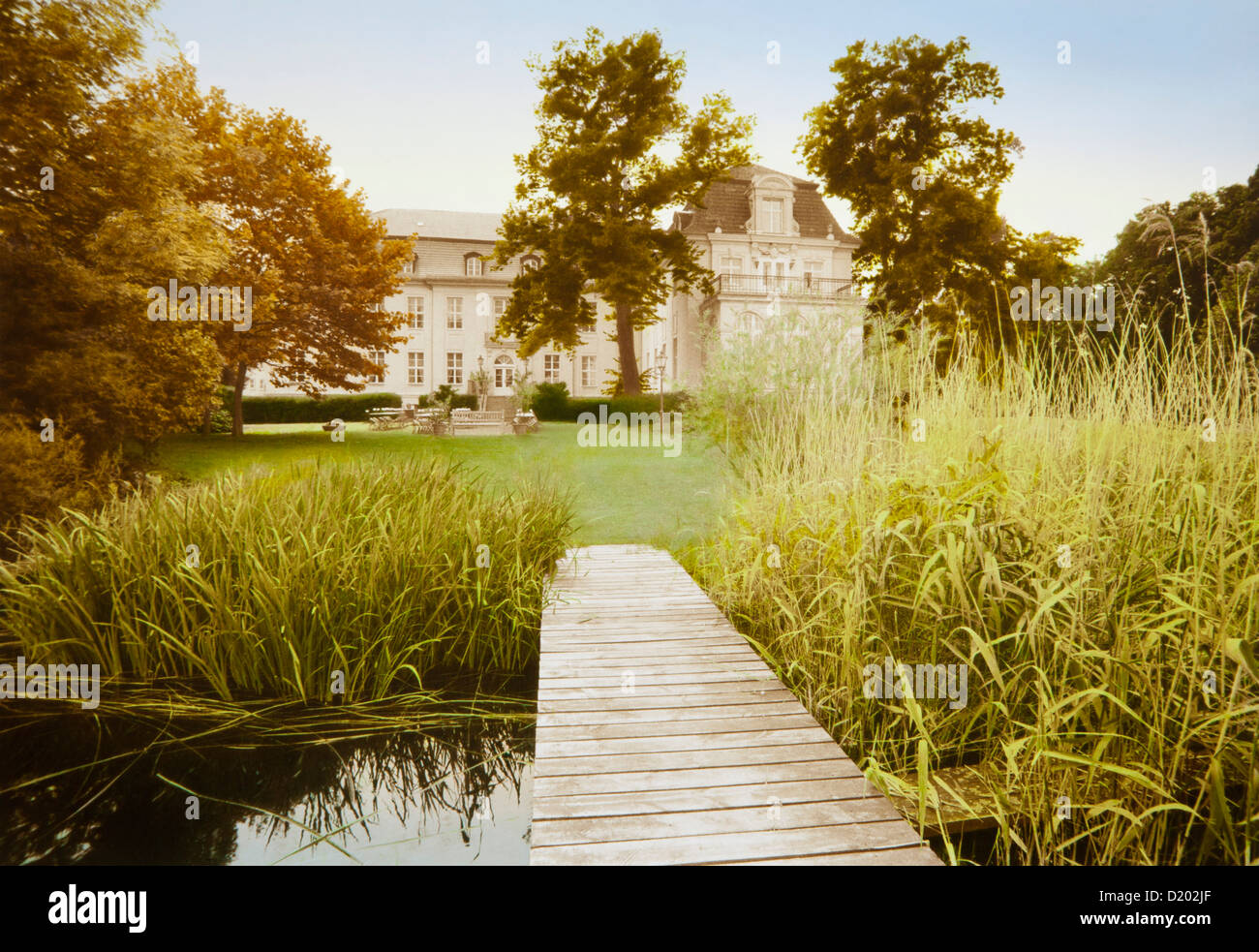 Pond and jetty in front of Zieten mansion, Wustrau, Brandenburg, Germany, Europe - Stock Image