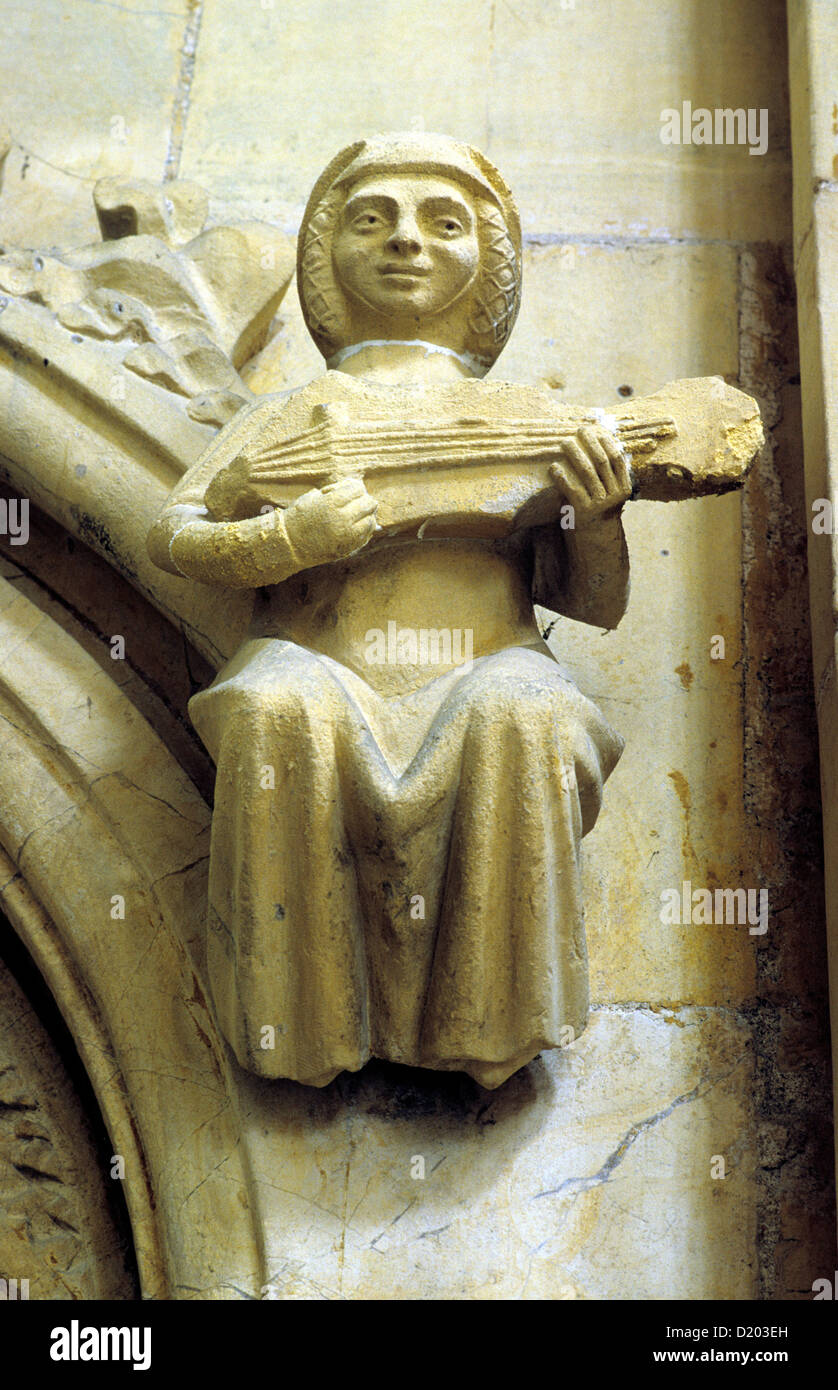 Beverley Minster, Medieval carved stone female Musician, stringed instrument, music, musicians musical, Yorkshire, - Stock Image