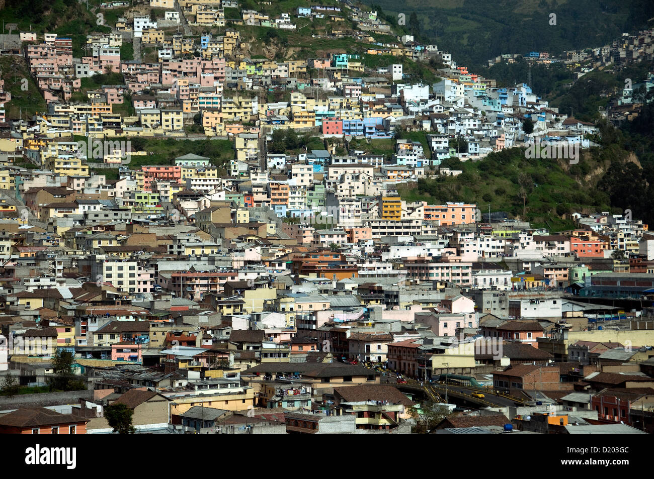Massed houses, home to some of Quito's more than 2.2 million population, covers a hillside outside Quito, Ecuador's - Stock Image